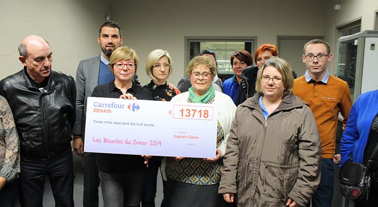 Chez Carrefour Denain, les «Boucles du Coeur» ont versé un chèque de 13 718 euros